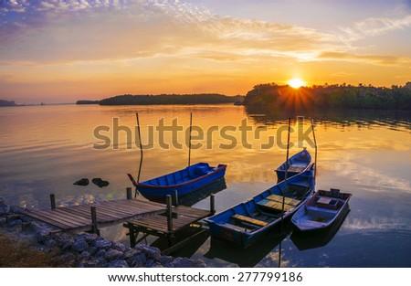 Sunrise at the beach with fisherman boat parking. Lumut Perak - stock photo