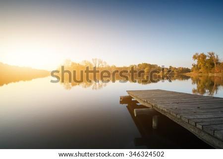 Sunrise at the lake - stock photo