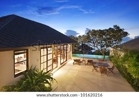 Sunrise at twilight in villa resort - stock photo