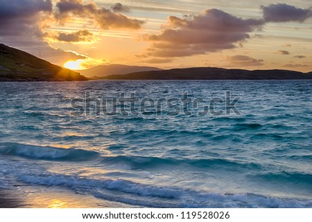 Sunrise at Vatersay Beach - Outer Hebrides of Scotland - stock photo