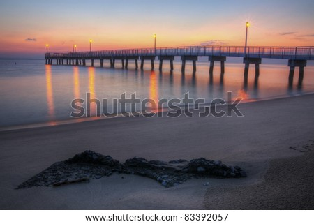 Sunrise at Woodland Beach Fishing Pier, Delaware. - stock photo
