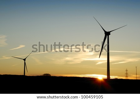 Sunrise behind a windfarm in Cornwall, UK.