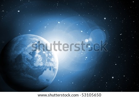 Sunrise behind the Earth in blue colors - stock photo