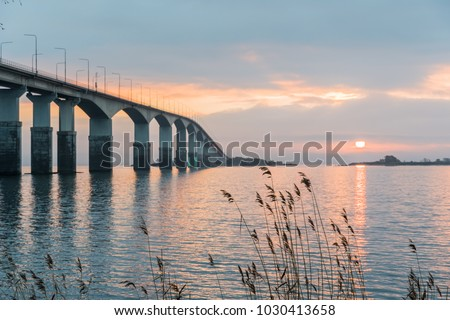 Sunrise by The Oland Bridge, connects the swedish island Oland in the Baltic Sea with mainland Sweden