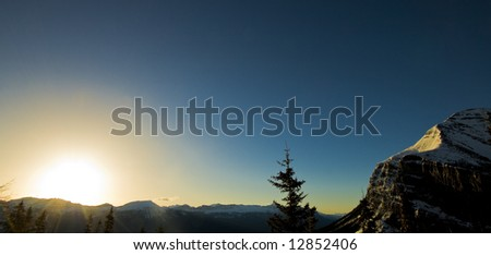 Sunrise dances over mountain range