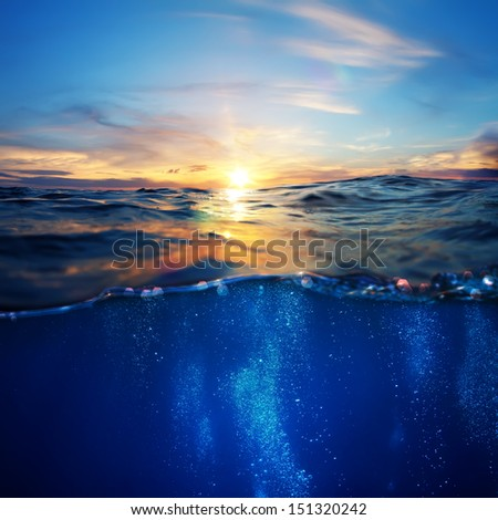 sunrise design template with underwater part and sunset skylight splitted by waterline - stock photo