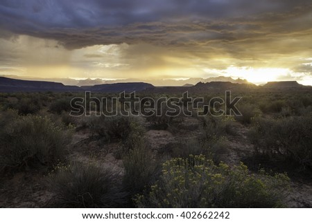 Sunrise during a rainstorm in Utah's desert southwest with Zion National park in the distance - stock photo