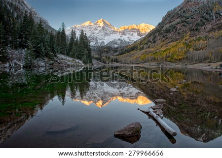 Sunrise, Fall Color, and Reflection at Maroon Bell - stock photo