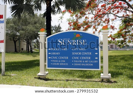 SUNRISE, FL, USA - JUNE 19, 2014: Large entrance sign that gives points various government agencies and building located in the area. Blue and white signage showing the way public buildings - stock photo