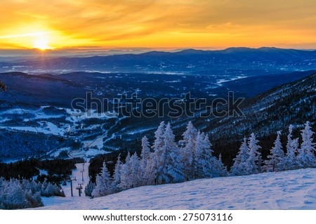Sunrise from the top of Mt. Mansfield in the winter, Stowe, Vermont, USA. - stock photo