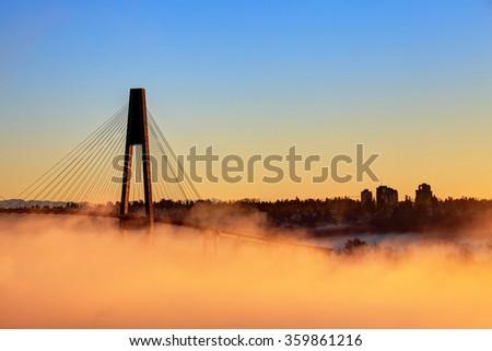 sunrise in a foggy morning - stock photo