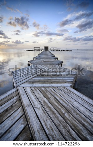 Sunrise in a Zig Zag dock in Spain - stock photo