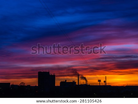 Sunrise in an industrial city - stock photo