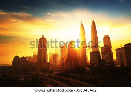 Sunrise in Kuala Lumpur with the silhouette of the Kuala Lumpur city skyline - stock photo