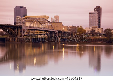 Sunrise in Little Rock, Arkansas. Blurred barque in the foreground. - stock photo