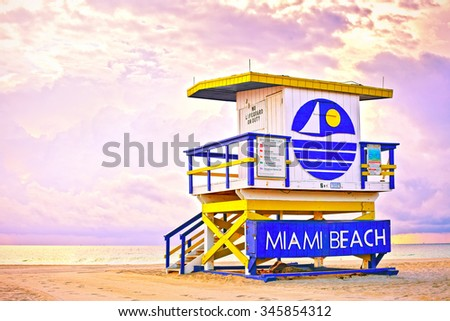 Sunrise in Miami Beach Florida, with a colorful lifeguard house in a typical Art Deco architecture, at sunrise with ocean and sky in the background.  - stock photo