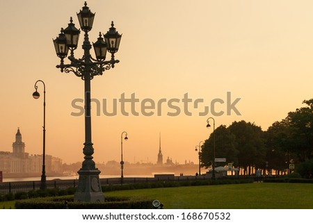 Sunrise in St. Petersburg, Russia. street lamp - symbol of the city. - stock photo