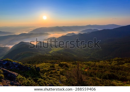 Sunrise in the Carpathian mountains, the morning mist in the mountains - stock photo