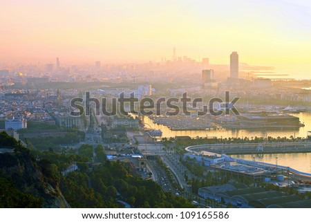 Sunrise in the city during the summer heat (Barcelona city, Spain, Europe) - stock photo