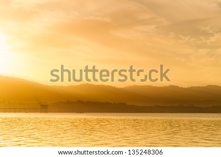 Sunrise in the morning landscape. At the edge of the reservoir. - stock photo