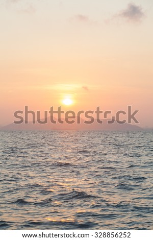 Sunrise in the morning. The sky was slightly overcast And a quiet sea - stock photo