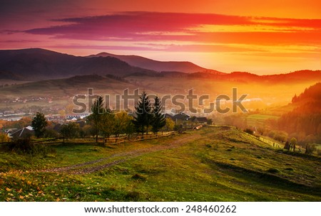 Sunrise in the mountain town of autumn morning in mountains Carpathians. - stock photo