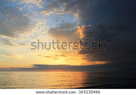 sunrise in the sea/Golden sky of a decline/A beautiful sunset sky over the sea. - stock photo
