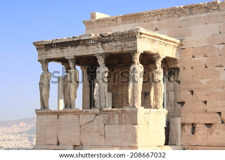 Sunrise lights the side porch of Caryatides in Erechtheum from Athenian Acropolis, Greece - stock photo