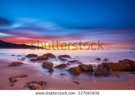 Sunrise long exposure on the California coast. - stock photo