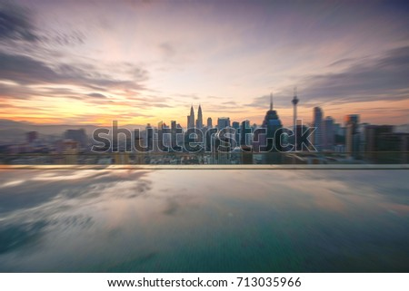 sunrise moments of kuala lumpur city centre with reflection and motion blur effect.