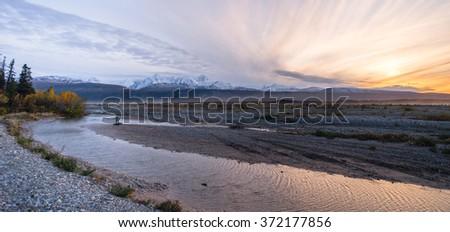 Sunrise Mountain Range Gulkana River Central Alaska - stock photo