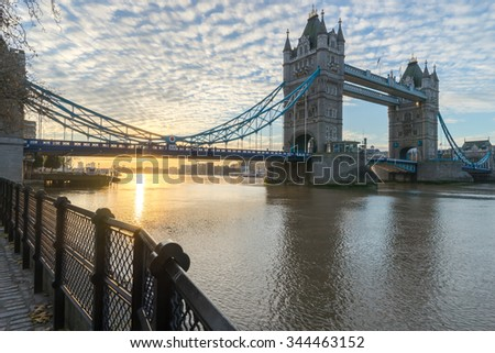 Sunrise of London Tower Bridge viewed from Tower of london side of the Thames river. - stock photo