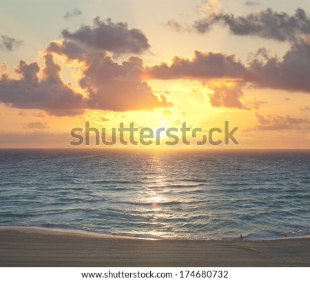 Sunrise on a beach in Cancun, Mexico - stock photo