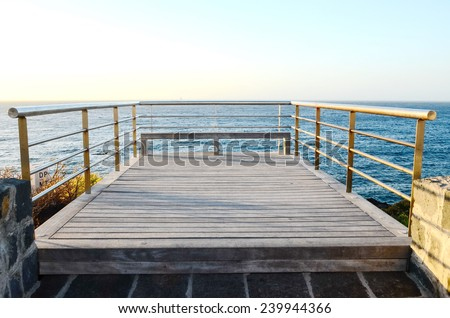 Sunrise on a Pier over Atlantic Ocean in Tenerife Canary Islands Spain - stock photo
