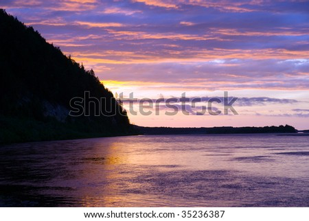 Sunrise on background of mountain and river. north europe - stock photo
