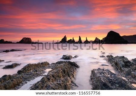 Sunrise on Gueirua beach in Asturias, Spain. - stock photo