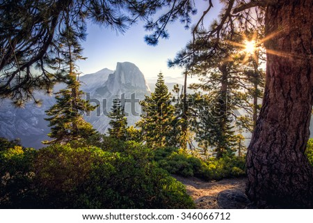 Sunrise on Half Dome in the Forest, Yosemite National Park, California  - stock photo
