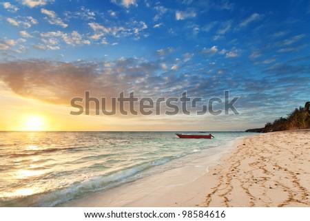 sunrise on nanuya island (sunrise beach, nanuya island,fiji) - stock photo