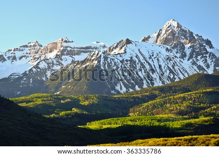 Sunrise on Snowy Mountain and Aspen Forest.  Mt Sneffles, Rocky Mountains, Colorado - stock photo