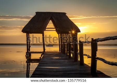 Sunrise on the Bacalar lagoon, Mexico, Riviera Maya - stock photo