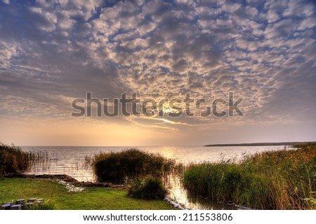 Sunrise on the Bay of Ahrenshoop in Germany, HDR - stock photo