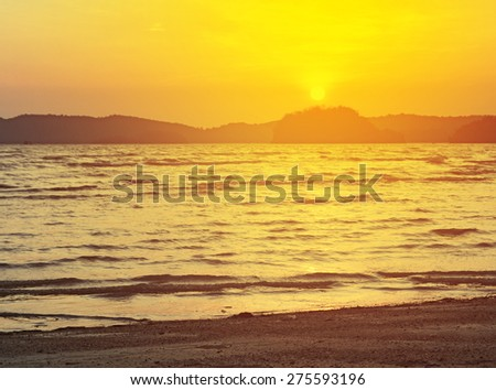 sunrise on the beach with twightlight - stock photo