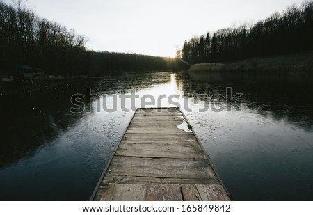 sunrise on the frost lake  - stock photo