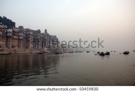 sunrise on the Ganga river in Varanasi, India - stock photo