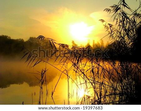 Sunrise on the lake - stock photo