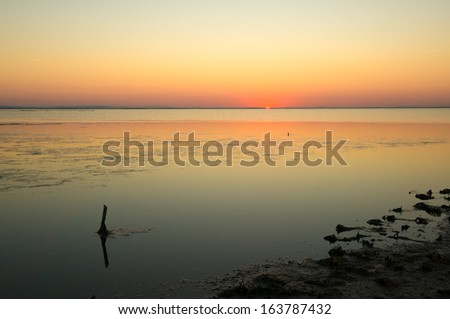 Sunrise on the lake of vaccares, Camargue, Provence, France - stock photo