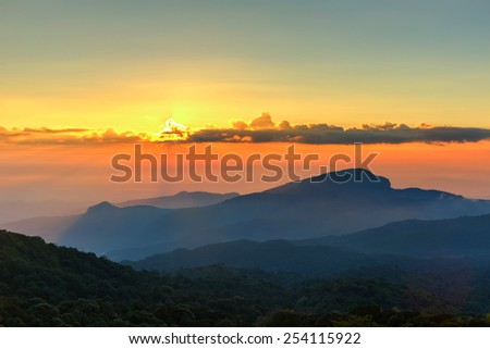 Sunrise on the mountain in the morning. - stock photo