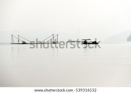 sunrise on thung nai lake , hoa binh , viet nam