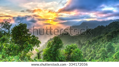 Sunrise on Yen Bai Heaven Gate peaks when the sun rises over the valley radiates ray with a bright yellow color to the highest forest area of Yen Bai, Vietnam - stock photo