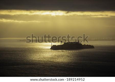 Sunrise over Alcatraz Island, San Francisco Bay - stock photo